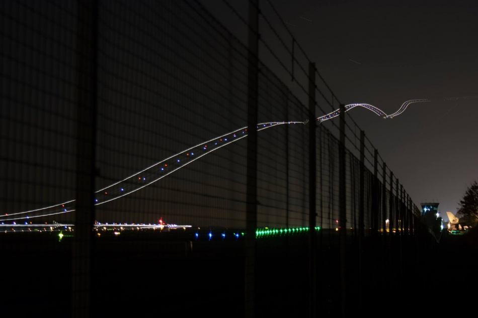 A long-exposure shot of a plane taking off.